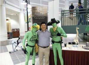 Chiropractor Burke VA James Go and green dressed men